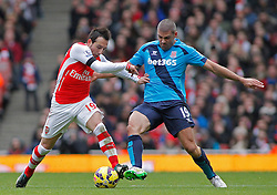 Arsenal's Santi Cazorla and Stoke's Jonathan Walters compete for the ball - Photo mandatory by-line: Mitchell Gunn/JMP - Mobile: 07966 386802 - 11/01/2015 - SPORT - football - London - Emirates Stadium - Arsenal v Stoke - Barclays Premier League