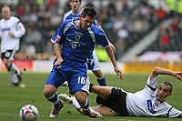 Photo: Pete Lorence.<br />Derby County v Cardiff City. Coca Cola Championship. 17/03/2007.<br />Joe Ledley is brought down by Derby's Craig Fagan.