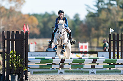 November 11, 2016 - Raeford, North Carolina, US - Nov. 12, 2016 - Raeford, North Carolina, USA - CAROLINE WOLVERTON and her horse, SPICE IT UP, clear a jump during the 2016 War Horse Event Series Championships, Nov. 12 at Carolina Horse Park in Raeford, N.C. Founded in 2013 as the Cabin Branch Event Series, the War Horse Event Series consists of five horse trials and combined tests and attracts riders and their horses from across the eastern United States. (Credit Image: © Timothy L. Hale via ZUMA Wire)