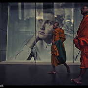 Buddhist monks make their way past a popular downtown Bangkok,Thailand shopping mall.