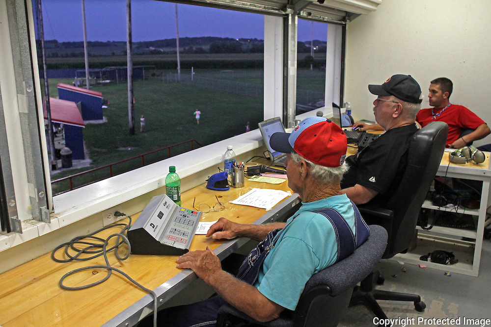 A's score keeper Edwin Ratashak, left, and announcer Tony Martin perform their duties from the Municipal Stadium press box.  photo by David Peterson