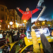 10/30/2013  BOSTON, MA  Fans celebrate by jumping on a moving cab on Massachusetts Avenue and Boylston Street in Boston after the Red Sox won Game 6 of the World Series.  (Aram Boghosian for The Boston Globe)