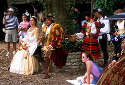 Stock photo of a man and woman in costume posing under a tree at the Texas Renaissance Festival in Plantersville Texas