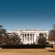 The White House with clear blue sky. The home and office of the President of the United States, the White House is at 1600 Pennsylvania Ave NW, Washington DC.