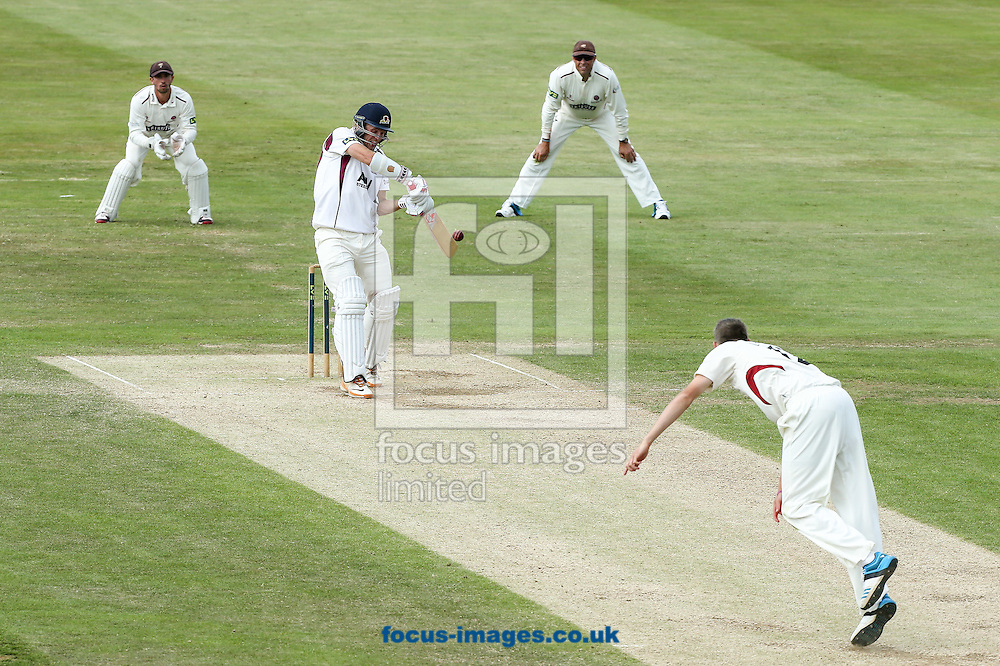 David Willey of Northamptonshire County Cricket Club (2nd left) hits the ball to the off side during the LV County Championship Div One match at the County Ground, Northampton<br /> Picture by Andy Kearns/Focus Images Ltd 0781 864 4264<br /> 15/07/2014