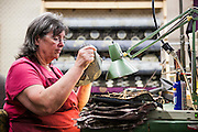 DEXTER, ME - AUGUST 4, 2015:  Corliss Fanjoy (63) an employee at Erda Handbags, works on a sewing machine at the company's production facility in Dexter, Maine. Since most of Erda's employees are 60 years or older they have implemented a flexible scheduling system and invested in more ergonomic machines to accommodate their aging workforce. <br /> Craig Dilger for The New York Times