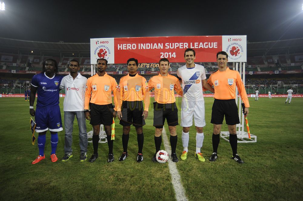 Bernard Mendy of Chennaiyin FC and Manuel Friedrich of Mumbai City FC pose with the referees and an Hero reperesentative during the toss before the start of match 15 of the Hero Indian Super League between Chennaiyin FC and Mumbai City FC held at the Jawaharlal Nehru Stadium, Chennai, India on the 28th October 2014.<br /> <br /> Photo by:  Pal Pillai/ ISL/ SPORTZPICS