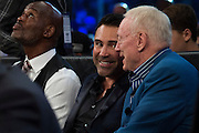 Oscar De La Hoya visits with Dallas Cowboys owner Jerry Jones between rounds of a fight at AT&T Stadium in Arlington, Texas on September 17, 2016.  (Cooper Neill for ESPN)