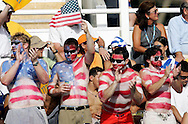 American fans with their bodies painted with a US flag root for  the  United States  in the bronze medal match in the Women's Water Polol at theOlympicv Aquatic Centre in Athens Thursday 26 August 2004.  The US won 6 to 5. (Photo by Patrick B. Kraemer / MAGICPBK)