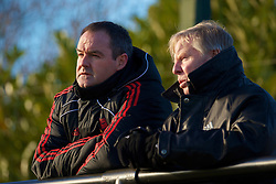 LIVERPOOL, ENGLAND - Tuesday, January 11, 2011: Liverpool's new assistant manager Steve Clarke and coach Sammy Lee watch the reserve team in action against Sunderland during the FA Premiership Reserves League (Northern Division) match at the Kirkby Academy. (Pic by: David Rawcliffe/Propaganda)