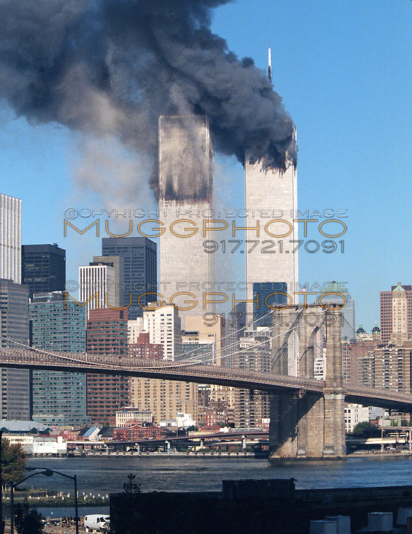 The World Trade Center moments after the South Tower was ...