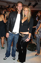 ADELA KING and BEN BLOOMFIELD at a party hosted by Jo Malone - Pomegranate Noir, held at The Vinyl Factory, 45 Foubert's Place, London W1 on 15th September 2005.<br /><br />NON EXCLUSIVE - WORLD RIGHTS