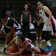 The Santa Ana College Dons women's basketball team sophomore guard (21) Lauren Fruto  (right) gets losses the ball and is forced into a tangle for possession of the ball by The Palomar Comets freshman guard (21) Regina Sheffield (left). The Dons would fall to the Comets 76-61.   Photo taken October 3rd 2016 at Santa Ana College in Santa Ana Calif..         Photo By: Daniel Bowyer/Sports Shooter Academy