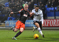 Fulham's Jack Grimmer competes with Bolton Wanderers' Liam Feeney - Photo mandatory by-line: Richard Martin-Roberts/JMP - Mobile: 07966 386802 - 10/02/2014 - SPORT - Football - Bolton - Macron Stadium - Bolton Wanderers v Fulham - Sky Bet Championship
