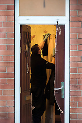 After a forced entry using a chainsaw South Yorkshire Police Officers execute a Warrant at an address in Eastwood Rotherham early on Tuesday Morning<br /> <br /> 04 March 2014<br /> Image © Paul David Drabble <br /> <br /> www.pauldaviddrabble.co.uk