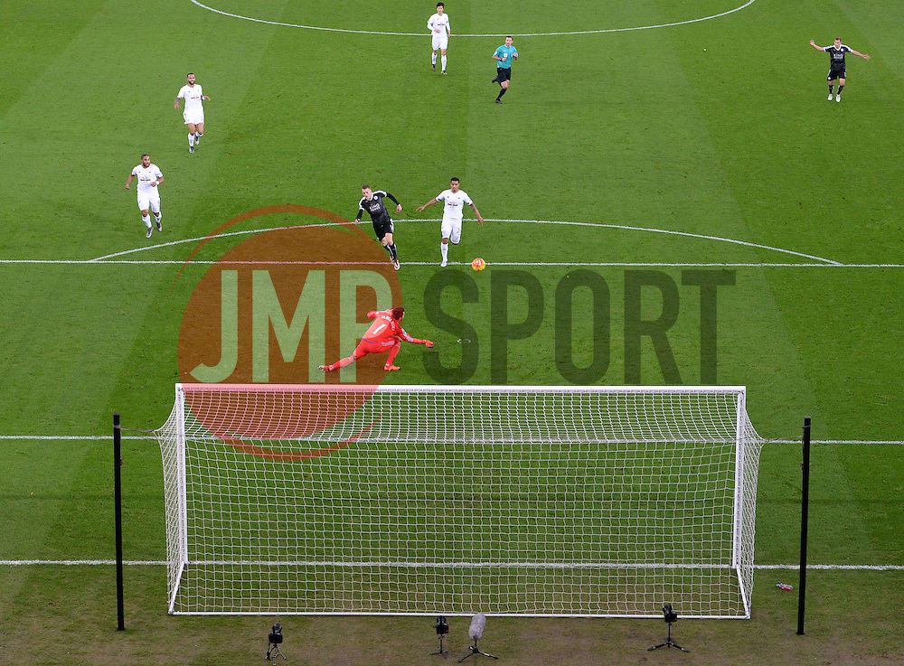 Jamie Vardy of Leicester City watches his shot saved by  Łukasz Fabiański of Swansea City - Mandatory byline: Alex James/JMP - 05/12/2015 - Football - Liberty Stadium - Swansea, Wales - Swansea City v Leicester City - Barclays Premier League