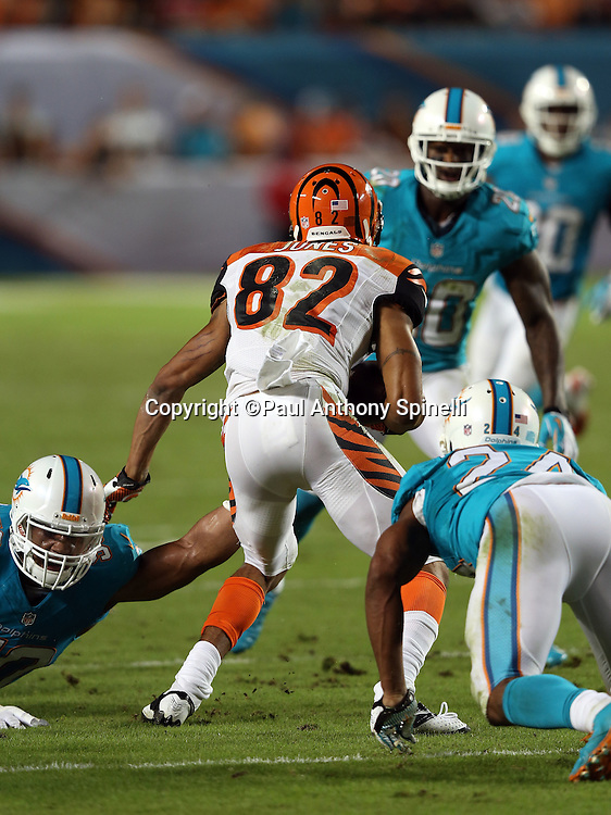 Cincinnati Bengals wide receiver Marvin Jones (82) catches a third quarter pass in the midst of a sea of Miami Dolphins defenders during the NFL week 9 football game against the Miami Dolphins on Thursday, Oct. 31, 2013 in Miami Gardens, Fla.. The Dolphins won the game 22-20 in overtime. ©Paul Anthony Spinelli