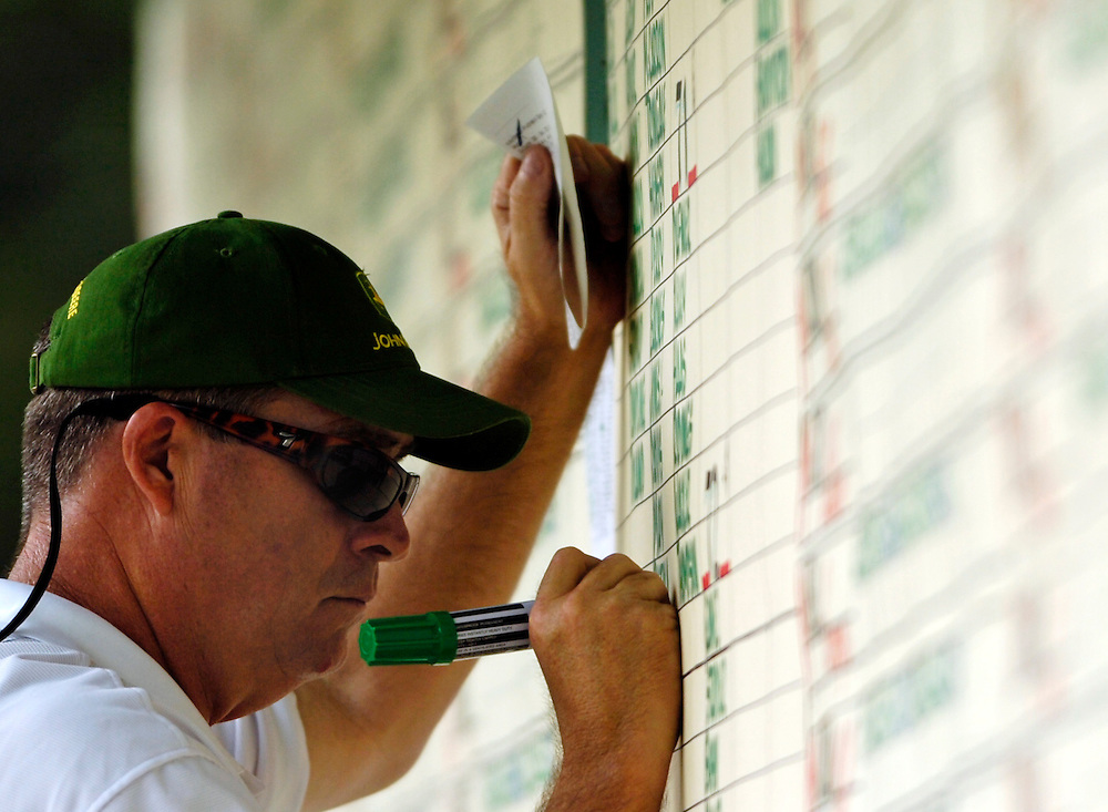 PGA calligrapher Ray Stansberry marks scores during the first round of the John Deere Classic golf tournament at TPC Deere Run in Silvis, Ill., on Thursday, July 7, 2011.  It is Stansberry's 17th year illustrating scores for the tournament.  (Brooks Canaday - Dispatch/Argus)