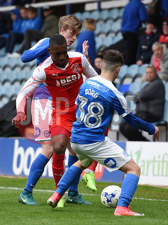 Andrea Borg (front) and Chris Forrester (back) of Peterborough United Peterborough United battle against Amari'i Bell of Fleetwood Town  - Mandatory by-line: Chantelle McDonald/JMP - 14/04/2017 - FOOTBALL - ABAX Stadium - Peterborough, England - Peterborough United v Fleetwood Town - Sky Bet League One