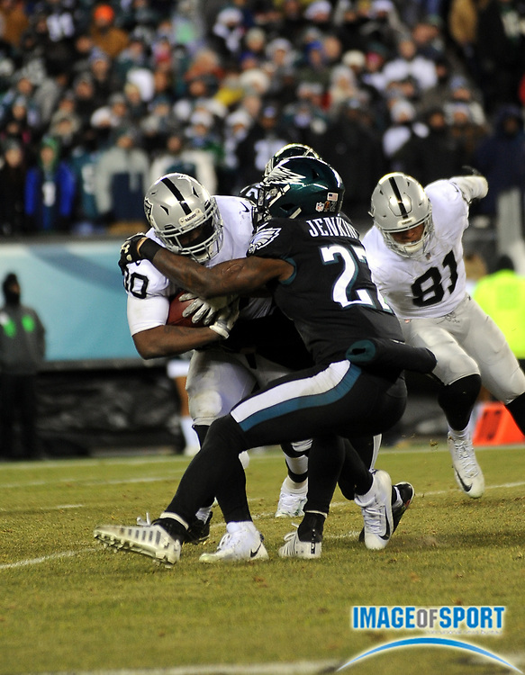 Dec 25, 2017; Philadelphia, PA, USA; Philadelphia Eagles safety Malcolm Jenkins (27) tackles Raiders return specialist Jalen Richard (30) during a NFL football game at Lincoln Financial Field. The Eagles defeated the Raiders 19-10. Photo by Reuben Canales