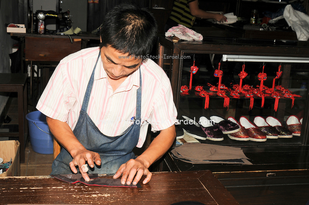 China, Zhejiang Province, Wuzhen traditional Shoemaker
