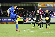 AFC Wimbledon defender Darius Charles (32) with a shot on goal during the EFL Sky Bet League 1 match between AFC Wimbledon and Wigan Athletic at the Cherry Red Records Stadium, Kingston, England on 16 December 2017. Photo by Matthew Redman.