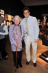 SIR TIM ACKROYD and BARONESS JAMES OF HOLLAND PARK at an auction and priavte view of paintings, drawings, stories and doodles by well known personalities held at Christie's, St.James's, London on 20th September 2010.