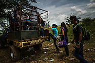 JULY 3, 2014: two sisters, and a friend from Honduras, ages 13, 14 and 16, arrive at a cattle ranch along the border between Guatemala and Mexico with their coyote that is smuggling them to the United States to be reunited with their parents, who have live and work in Texas and California. The sisters have not seen their parents for six years, their friend has not seen her parents for 12 years.  PHOTO: Meridith Kohut for The New York Times