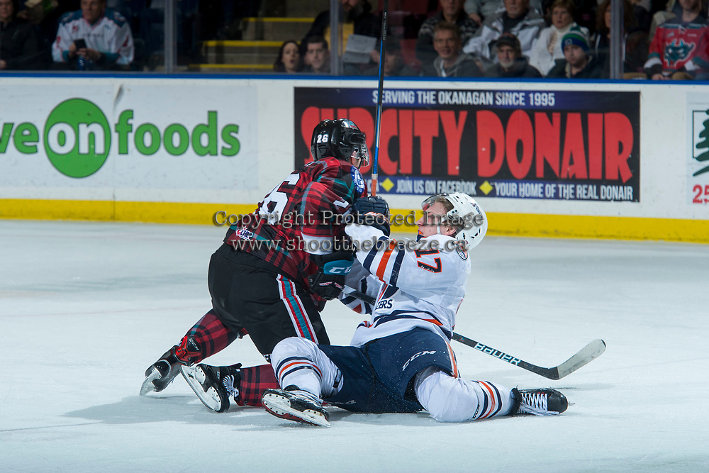 KELOWNA, CANADA - MARCH 10: Kole Lind #16 of the Kelowna Rockets checks Brodi Stuart #17 of the Kamloops Blazers on March 10, 2018 at Prospera Place in Kelowna, British Columbia, Canada.  (Photo by Marissa Baecker/Shoot the Breeze)  *** Local Caption ***