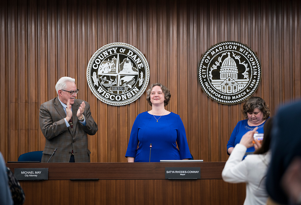 Madison Mayor Satya Rhodes-Conway looks out at the crowd after being sworn in by City Clerk Maribeth Witzel-Behl at the City County Building in Madison, WI on Tuesday, April 16, 2019.