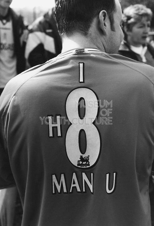 Man wearing a football strip printed with 'I H8 Man U'