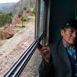 Juan Lazaro, the train fare inspector, takes a break in between stations.