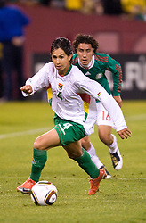 February 24, 2010; San Francisco, CA, USA;  Bolivia defender Marvin Bejarano (4) dribbles past Mexico defender Efrain Juarez (16) during the second half at Candlestick Park. Mexico defeated Bolivia 5-0.