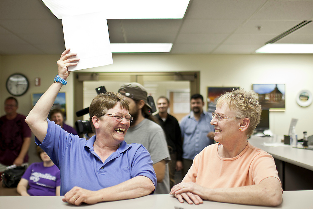 Nancy Ryherd (left) and Linda Schroeder smile as Ryherd holds their civil union license up for the room to see in the county clerk's office at the Macon County Office Building just after 12 midnight Wednesday, June 1, 2011, in Decatur, Ill. (Stephen Haas)