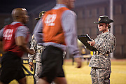 A female Drill Sergeant instructor monitors Drill Sergeant candidates at the US Army Drill Instructors School Fort Jackson during the entry physical training test early morning September 27, 2013 in Columbia, SC. While 14 percent of the Army is women soldiers there is a shortage of female Drill Sergeants.