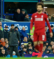 LIVERPOOL, ENGLAND - Sunday, March 3, 2019: Liverpool's manager Jürgen Klopp looks on at Mohamed Salah during the FA Premier League match between Everton FC and Liverpool FC, the 233rd Merseyside Derby, at Goodison Park. (Pic by Paul Greenwood/Propaganda)