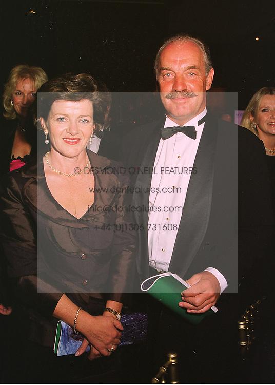 MR & MRS DERMOT DESMOND the Irish multi-millionare, at a dinner in London on 19th May 1998.MHS 93