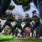 Seattle Seahawks players get hyped before the NFC Divisional Playoff against the Carolina Panthers. The Seahawks defeated the Panthers 31-17. Photographed on Saturday January 10, 2015 at CenturyLink Field in Seattle. (Joshua Trujillo, seattlepi.com)