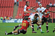 JOHANNESBURG, South Africa, 02 April 2011. Digby Ioane of the Reds is tackled by Andre Pretorius of the Lions during the Super15 Rugby match between the Lions and the Reds at Coca-Cola Park in Johannesburg, South Africa on 02 April 2011. .Photographer : Anton de Villiers / SPORTZPICS