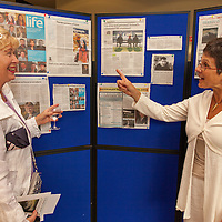 Maria Molloy from Ennis and Doireann Ní Bhriain (Volunteer Press Officer for Cumann Merriman) reviewing the media coverage of the 2014 Merriman Summer School in Glór