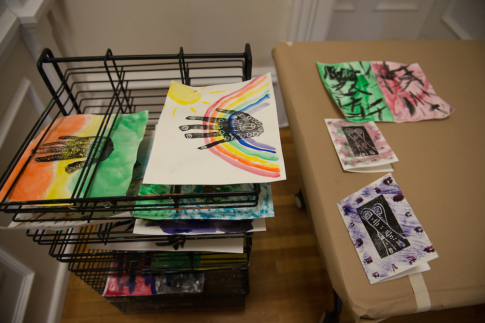 Prints dry on a rack at Fall Family Day at the Kennedy Museum of Art Saturday, September 29.
