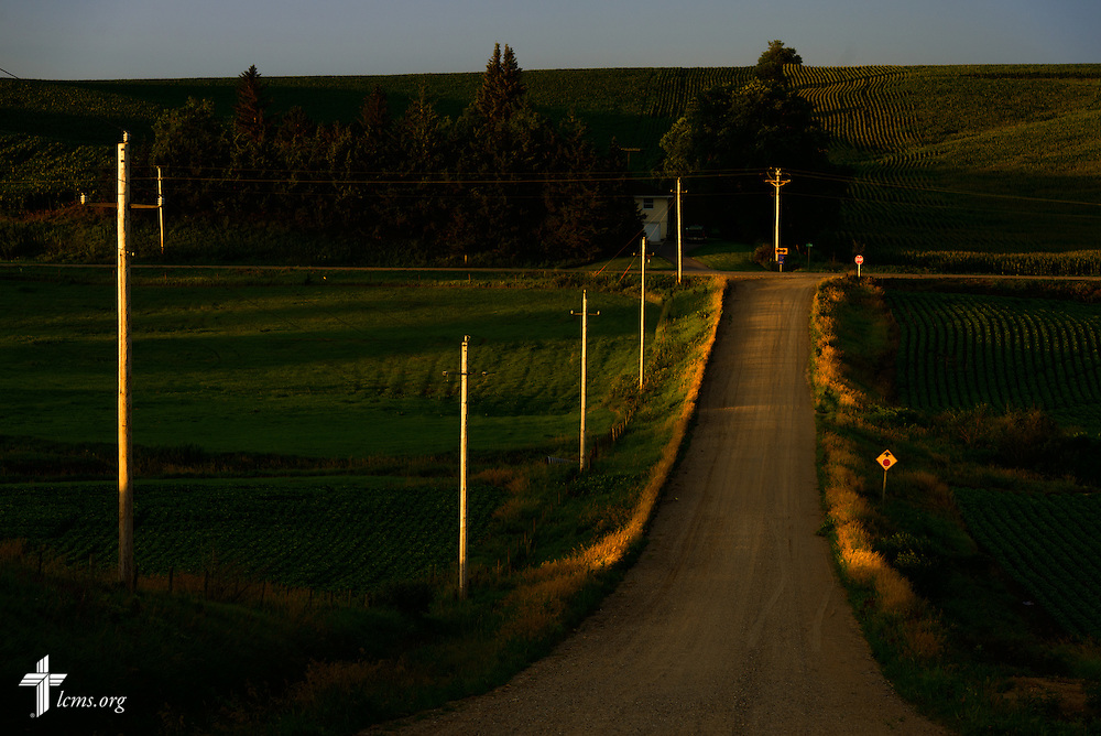 A road is lit by the rising sun on Sunday, July 19, 2015, near Mission Central in Mapleton, Iowa. LCMS Communications/Erik M. Lunsford