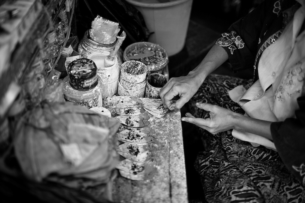 A local vendor sells the ubiquitous Kunya, the Burmese version of betel nut, which when chewed, produces a bright red spit and black stained teeth.