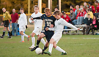 Bow's Ryan Hill and Hopkinton's Henry Merrow battle for the ball during NHIAA Division  Soccer at Hopkinton High School Monday afternoon.  (Karen Bobotas/for the Concord Monitor)