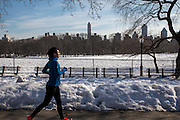 A woman in sports clothes runs along a path that has been cleared from snow in West side Central Park, Manhattan, New York City, New York, United States of America. The city has just had a record breaking snow storm in January 2016.  (photo by Andrew Aitchison / In pictures via Getty Images)