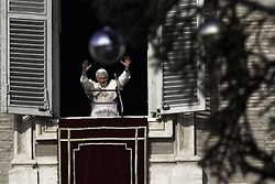 Pope Benedict XVI blesses faithful as he leads the Angelus prayer from a window of his apartments, December 23, 2012. Photo by Imago / i-Images...UK ONLY