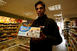 UK ENGLAND BERKSHIRE UPPER BUCKLEBURY 22MAR11 - Hash Shingadia (52) displays Prince William's favourite ice cream at his Spar store in Upper Bucklebury, Berkshire, England. He took over the village's Peaches Store 13 years ago and is the proud recipient of an invite to the Royal Wedding of Kate Middleton and Prince William...jre/Photo by Jiri Rezac..© Jiri Rezac 2011
