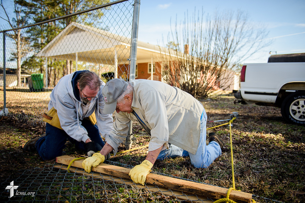 Volunteers Jim Kelliher and Gerald Jomp (center), work together to repair a fence at Nanny's Korner Care Center on Thursday, Jan. 19, 2017, in Lumberton, N.C. The center was damaged in October from flooding related to Hurricane Matthew. LCMS Communications/Erik M. Lunsford