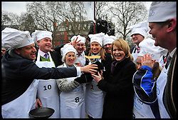 The MP's team celebrate winning the MP's and Lords race against political Journalist in the Rehab Parliamentary Pancake Shrove Tuesday race a charity event which sees MPs and Lords joined by media types in a race to the finish. Victoria Tower Gardens, Westminster, Tuesday February 12, 2013. Photo By Andrew Parsons / i-Images