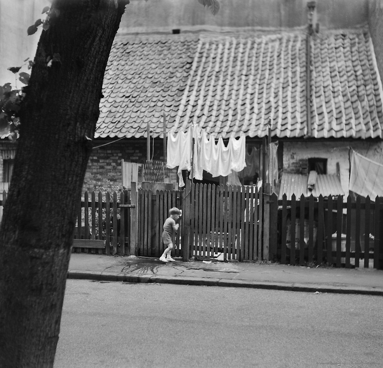 Small Child, laundry Outside Cottages at Highgate, London, c. 1945